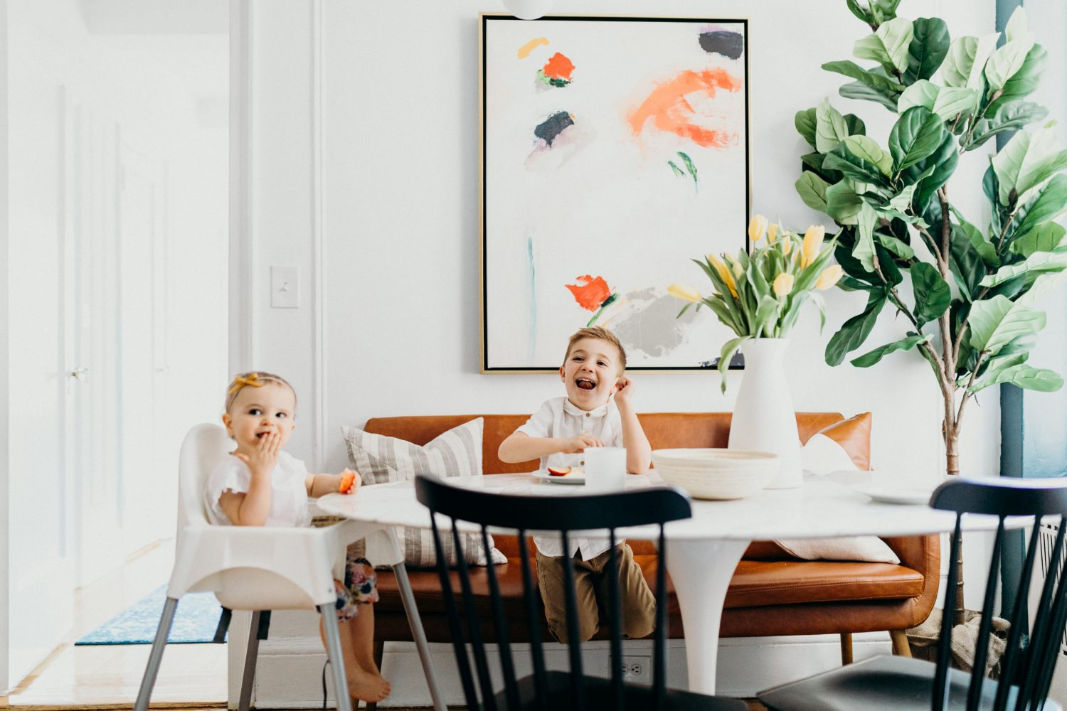 kids eating at modern table with urban outfitters leather couch